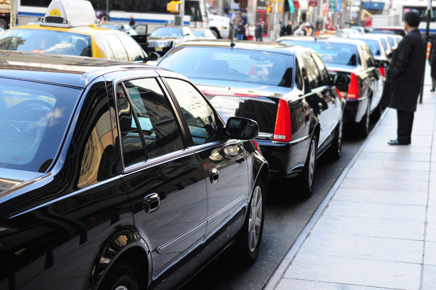 Several limousines parked on a street